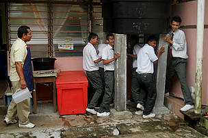 Students setting up the water tank near the school canteen